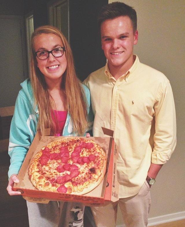 Matt Scheneman asks Emily Nightingale to Homecoming with pizza.
