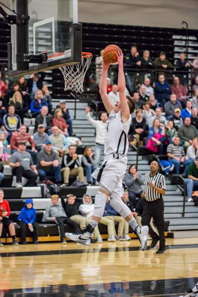 Tyler Bosma dunking at a game.