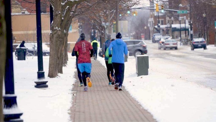 Runners regularly run downtown on the snowmelt during the winter