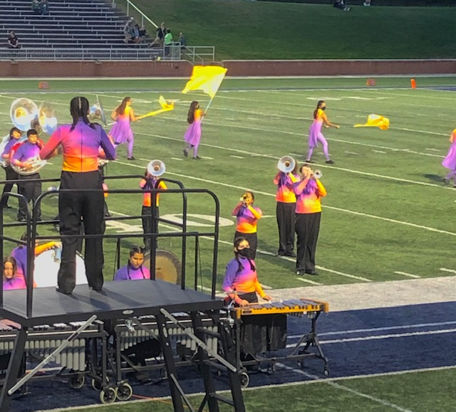 The Holland High School band is dressed in bright colors as Jack takes the field for the first time.